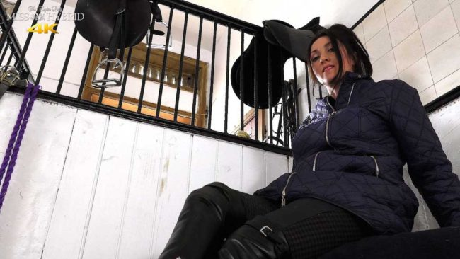 Miss Hybrid easy access jodhpurs, leather gloves and leather boots in the Manor stables.